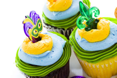 Fancy cupcakes decorated with leaf and mask for Mardi Gras party. Stock Photo - 17489895