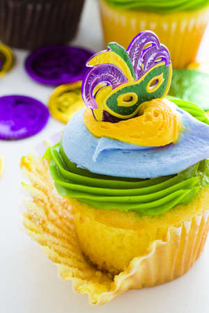 Fancy cupcakes decorated with leaf and mask for Mardi Gras party. Stock Photo - 17489861