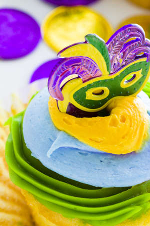Fancy cupcakes decorated with leaf and mask for Mardi Gras party. Stock Photo - 17489832