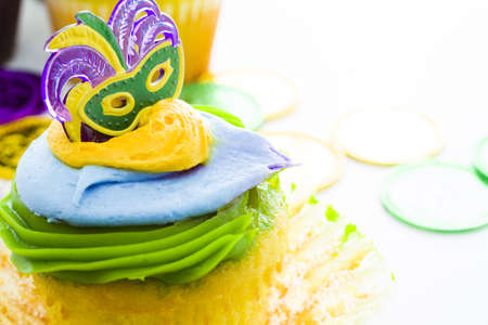 Fancy cupcakes decorated with leaf and mask for Mardi Gras party. Stock Photo - 17489681