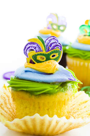 Fancy cupcakes decorated with leaf and mask for Mardi Gras party. Stock Photo - 17489670