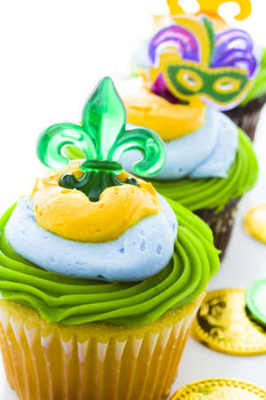 Fancy cupcakes decorated with leaf and mask for Mardi Gras party. Stock Photo - 17489904
