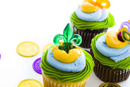 Fancy cupcakes decorated with leaf and mask for Mardi Gras party. Stock Photo - 17489663