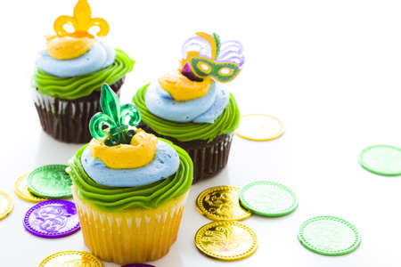 Fancy cupcakes decorated with leaf and mask for Mardi Gras party. Stock Photo - 17489630