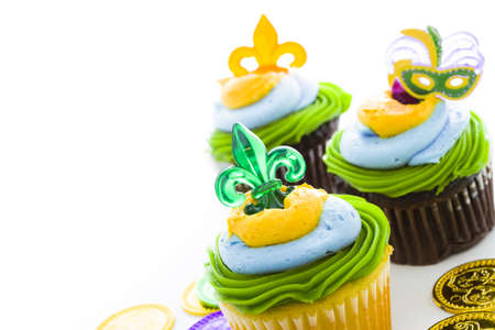 Fancy cupcakes decorated with leaf and mask for Mardi Gras party. Stock Photo - 17489623