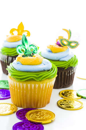 Fancy cupcakes decorated with leaf and mask for Mardi Gras party. Stock Photo - 17489714