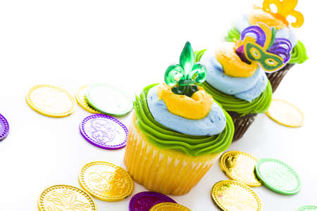 Fancy cupcakes decorated with leaf and mask for Mardi Gras party. Stock Photo - 17489649