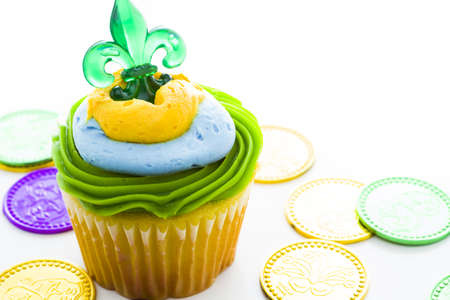 Fancy cupcakes decorated with leaf and mask for Mardi Gras party. Stock Photo - 17489628