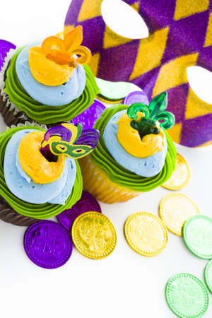 Fancy cupcakes decorated with leaf and mask for Mardi Gras party. Stock Photo - 17489882