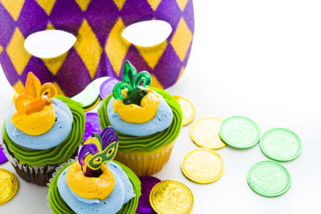 Fancy cupcakes decorated with leaf and mask for Mardi Gras party. Stock Photo - 17489698