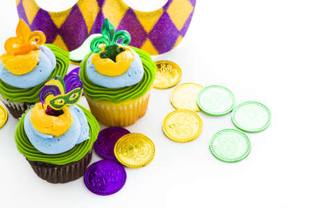Fancy cupcakes decorated with leaf and mask for Mardi Gras party. Stock Photo - 17489662