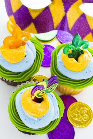 Fancy cupcakes decorated with leaf and mask for Mardi Gras party. Stock Photo - 17489828