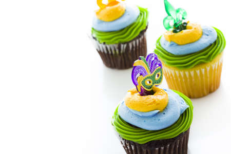 Fancy cupcakes decorated with leaf and mask for Mardi Gras party. Stock Photo - 17489625