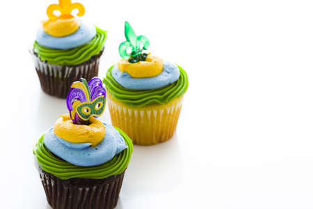 Fancy cupcakes decorated with leaf and mask for Mardi Gras party. Stock Photo - 17489617