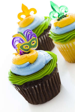 Fancy cupcakes decorated with leaf and mask for Mardi Gras party. Stock Photo - 17489936