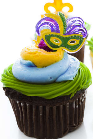 Fancy cupcakes decorated with leaf and mask for Mardi Gras party. Stock Photo - 17489902
