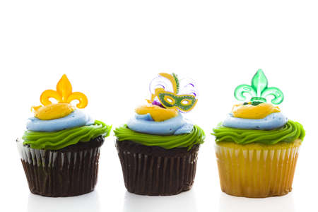 Fancy cupcakes decorated with leaf and mask for Mardi Gras party. Stock Photo - 17489616