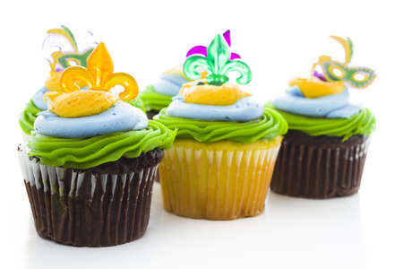 Fancy cupcakes decorated with leaf and mask for Mardi Gras party. Stock Photo - 17489650