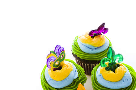 Fancy cupcakes decorated with leaf and mask for Mardi Gras party. Stock Photo - 17489612