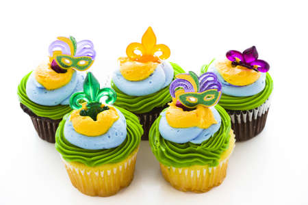 Fancy cupcakes decorated with leaf and mask for Mardi Gras party. Stock Photo - 17489674