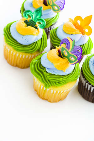 Fancy cupcakes decorated with leaf and mask for Mardi Gras party. Stock Photo - 17489696