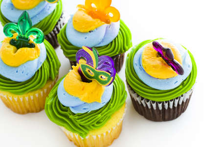 Fancy cupcakes decorated with leaf and mask for Mardi Gras party. Stock Photo - 17489910