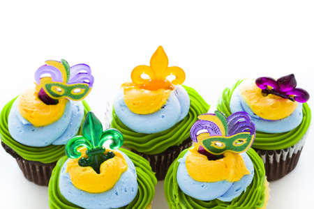 Fancy cupcakes decorated with leaf and mask for Mardi Gras party. Stock Photo - 17489665