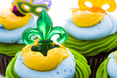 Fancy cupcakes decorated with leaf and mask for Mardi Gras party. Stock Photo - 17489852