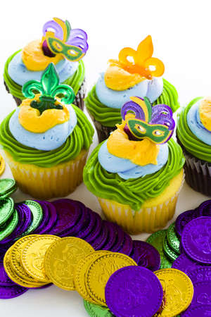 Fancy cupcakes decorated with leaf and mask for Mardi Gras party. Stock Photo - 17489780