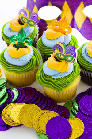 Fancy cupcakes decorated with leaf and mask for Mardi Gras party. Stock Photo - 17489762