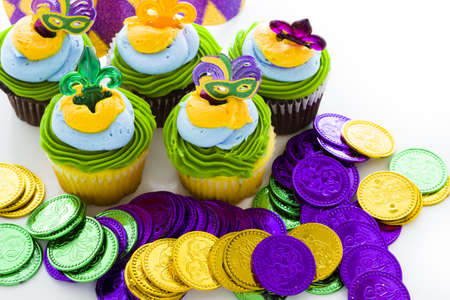 Fancy cupcakes decorated with leaf and mask for Mardi Gras party. Stock Photo - 17489763