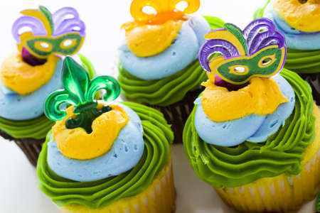 Fancy cupcakes decorated with leaf and mask for Mardi Gras party. Stock Photo - 17489804