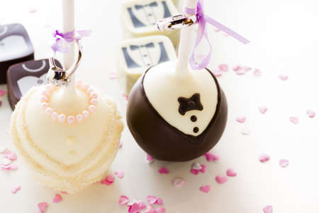 Chocolate cake pops decorated for wedding party.