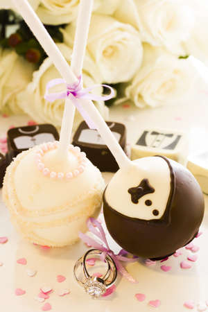 Chocolate cake pops decorated for wedding party. photo