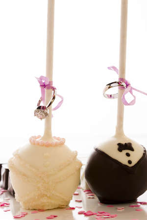 Chocolate cake pops decorated for the wedding party. photo