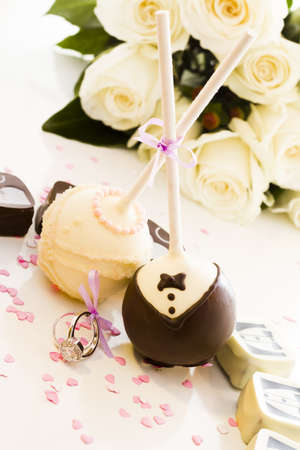 baked treat: Chocolate cake pops decorated for the wedding party.