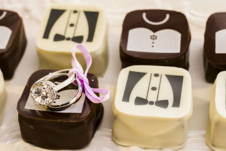 Small chocolates decorated for the wedding party.