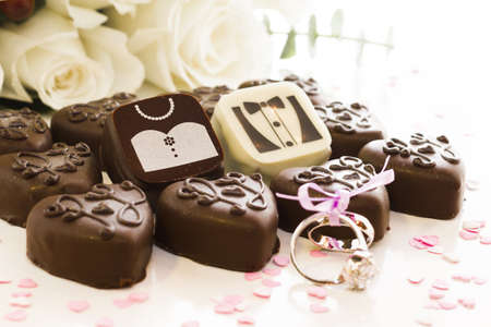 Small chocolates decorated for the wedding party. photo