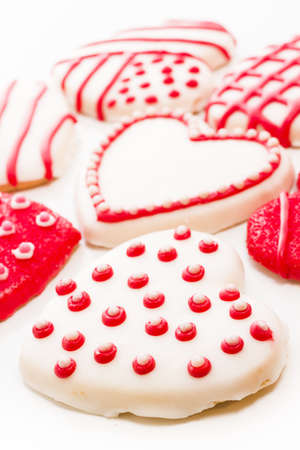 baked treat: Gourtmet heart shaped cookies decorated for Valentines Day. Stock Photo