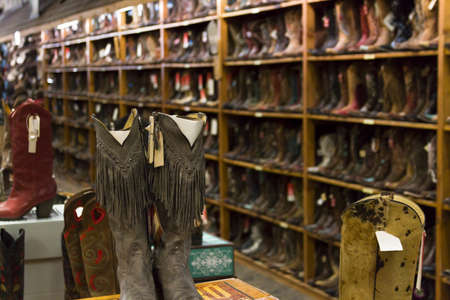 Cowboy boots on dispaly in the store.