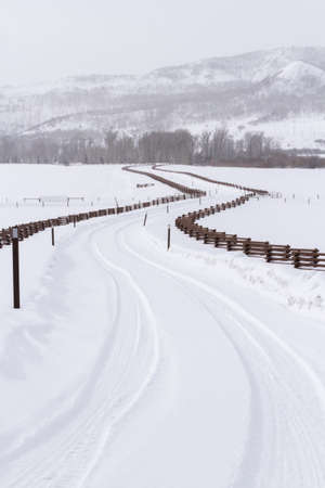 split rail: Road to private ranch with split rail fence.