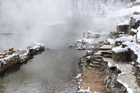 hot springs: Strawberry Hot Springs surrounded by winter forest.