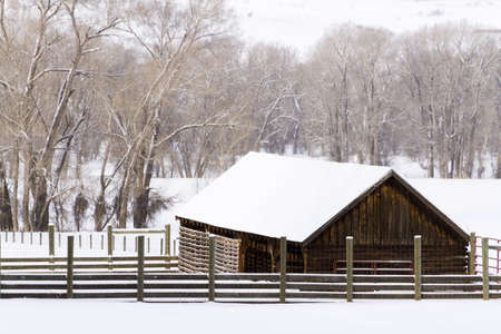 Old barn in snow on rural ranch. Stock Photo - 17950875