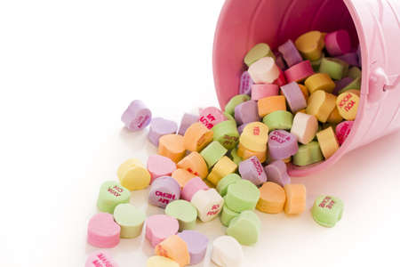 Conversation heart candies spilled from pink bucket. Stock Photo - 17855581
