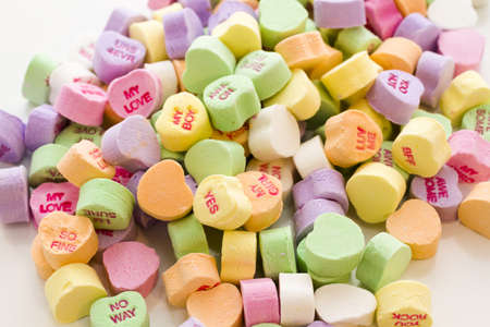 candy hearts: Pile of conversation heart candies on white background.