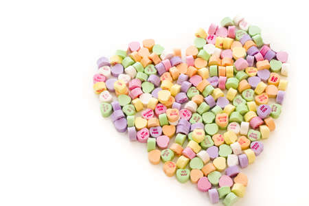 candy hearts: Pile of conversation heart candies in heart shape.