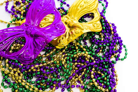 Mardi Gras beads and colorful mask on white backgound. Stock Photo - 17874141