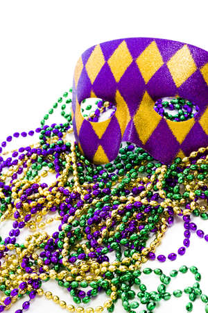 Mardi Gras beads and colorful mask on white backgound. Stock Photo - 17874149