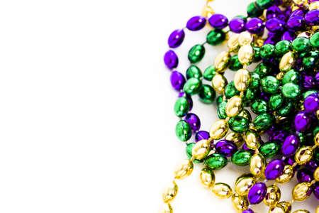 Mardi Gras beads on white backgound.