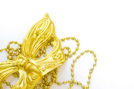 Mardi Gras gold beads and mask on white backgound. Stock Photo - 17874157